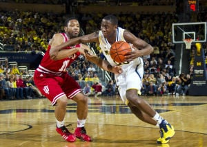Robinson III leads Michigan over Indiana