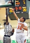 LaPorte's Miles Browder shoots over Michigan City's Anthony Simmons during the second quarter Saturday.