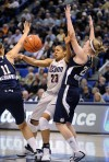 Moore and Dolson lead UConn to Big East title