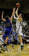 Bishop Noll's Milos Kostic shoots over a Tipton defender