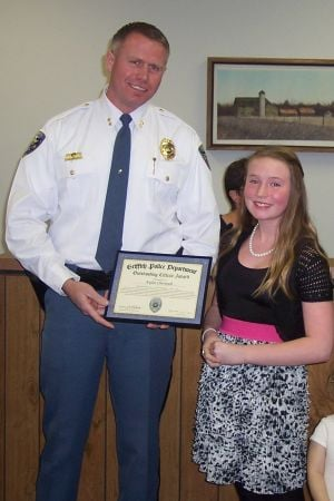 Youth honored for helping at accident scene