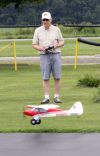 Remote controlled plane enthisiasts at the Midwest Sundowners field