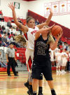 Lowell's Hunter Jusevich tries to shoot over Portage's Lindsay Givens