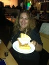 Times Restaurant Columnist Eloise Valadez Displaying a Waffle and Fried Chicken Sandwich at The Game at Blue Chip Casino