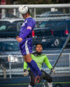 Thornton's Francisco Carbajal heads the ball away from his goal while goalkeeper Jose Navarro watches.