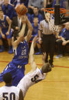 Lake Central's Cory Dickelman drives against Homestead during Saturday's Class 4A Lafayette Jeff Semistate.