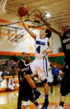 Clark's Jacob Trevino drives for a layup Saturday at Wheeler.