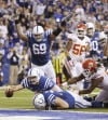 Colts quarterback Andrew Luck dives for a touchdown after recovering a fumble by the Colts' Eric Berry during the second half of an NFL wild-card playoff football game against Kansas City.