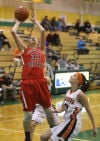 South Central's Riley Popplewell scores over Westville's Stephanie Popp during Tuesday's PCC tourney.