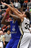 Lake Central's Tyler Wideman is fouled by Penn's Taylor Brooks during Saturday night's Class 4A Michigan City Regional final.