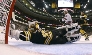 Blackhawks work to keep distracting Bruins' goalie Rask