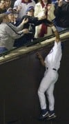 Steve Bartman knocks ball away from Moises Alou