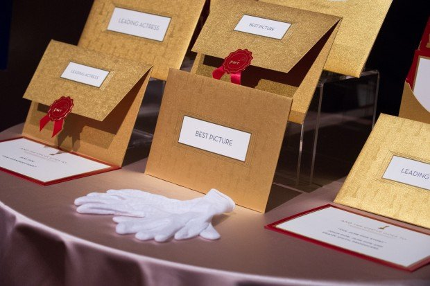 envelopes containing Academy Award winners are shown.