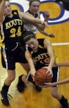 Kouts' Shelby Jones grabs a rebound