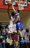 Lake Central's Cory Dickelman blocks a shot by E.C. Central's Jalen Blackmon during Friday's semifinals of the Class 4A E.C. Central Sectional.