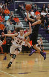 LaPorte's Jaclyn Heath passes in front of Hobart's Kara Cooke en route to the lane during Tuesday's Class 4A Hobart Sectional.