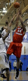 Homewood-Flossmoor's Maurius Hill shoots over Bloom Township's Nhyree Mitchell