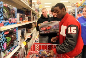 MHS football team helps brighten holiday for children