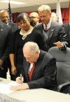 Quinn signs south suburban rail law