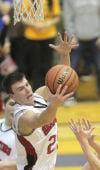 Washington Township junior Nathan Line grabs a rebound against Hebron