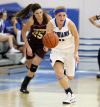 Lake Central's Tara Zlotkowski drives toward Lake Central's basket with Chesterton's Lauren Kusbel in pursuit
