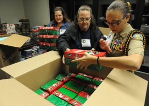 Group at Dyer church packs gifts for children around the world