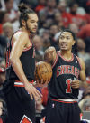 Bulls guard Derrick Rose, right, talks with center Joakim Noah during the first half of Thursday's home opener.