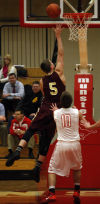 Chesterton's Chris Palombizio drives past Munster's Mike Hayes for a layup Tuesday night.