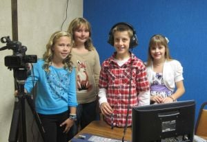 Morning news crew broadcasts at Jackson Elementary