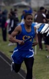 Crete-Monee's Aki Allen runs in the 800 meter relay