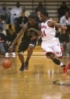 Bowman's Davon Dillard is guarded by E.C. Central's Martayveus Carter on Tuesday.