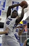 Lake Central's Tyler Wideman grabs a rebound