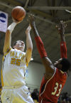 Valpo's Alec Peters shoots over UIC's Ahman Fells during Tuesday night's game in the Horizon League Tournament.