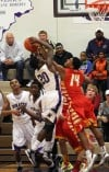 Merrillville's B.J. Jenkins battles for a rebound 