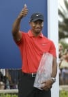 Woods keeps it dry and wins Players Championship