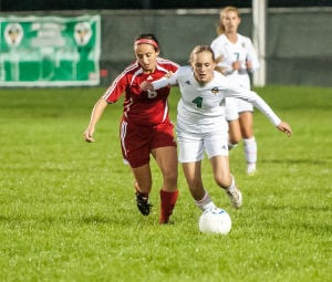 Valparaiso's Kelly Landry, right, and Munster's Erin Gallagher