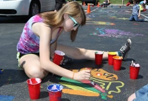 Kids paint the parking lot at Crete Library
