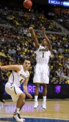 Michigan freshman and St. John native Glenn Robinson III shoots while teammate and Chesterton native Mitch McGary works for position