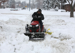 Region slogs through another snowstorm