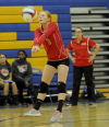 T. F. South coach Kim Sands watches as Brittany Kooi bumps the ball