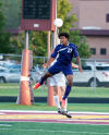 Merrillville's Jamal Duke gos up for a header off a corner kick