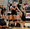 Lake Central players surround sophomore middle hitter Brooke Renner