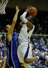 Bishop Nolls's Adonis Filer shoots over a Tipton defender