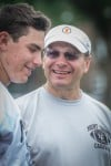 Mount Carmel football oach Frank Lenti, right, talks with quarterback Marko Boricich