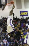 T.F. North's Vance Johnson misses a dunk against Eisenhower in North's 79-78 win.
