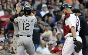 Carp lifts Red Sox over White Sox in 10
