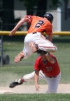Westville's Chase Kourtis as tagged out at third base by Washington Township's Corey Holderread