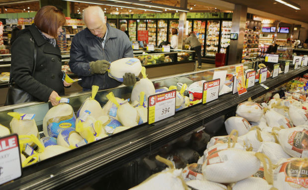 Shoppers trot for bargain turkeys at local grocers