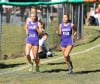 Hobart's Celena Guerrero (right) and Mindy Whidden (left) run together to help keep each other up to pace Saturday morning during the last leg of the Bob Thomas Invitational. Guerrero finished second in 18:45, while Whidden was fourth in 19:39.