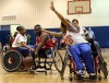 Wheelchair basketball players exhibit their skill for youngsters